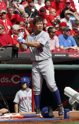 Sep 25, 2013; Cincinnati, OH, USA; New York Mets starting pitcher Daisuke Matsuzaka prepares on deck during a game against the Cincinnati Reds at Great American Ball Park. Mandatory Credit: David Kohl-USA TODAY Sports