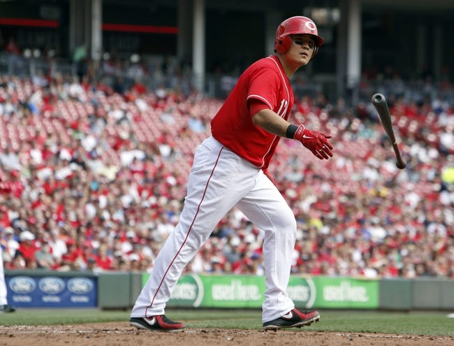 Sep 25, 2013; Cincinnati, OH, USA; Cincinnati Reds center fielder Shin-Soo Choo walks to first in the third inning during a game against the New York Mets at Great American Ball Park. Mandatory Credit: David Kohl-USA TODAY Sports