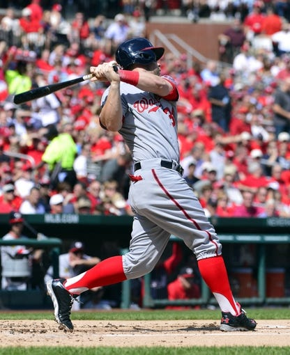 Sep 25, 2013; St. Louis, MO, USA; Washington Nationals left fielder Bryce Harper (34) hits an RBI base hit against the St. Louis Cardinals during the first inning at Busch Stadium. Mandatory Credit: Scott Rovak-USA TODAY Sports