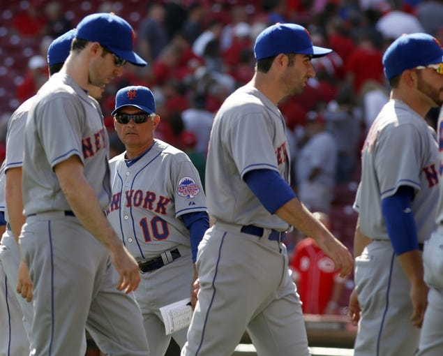 Sep 25, 2013; Cincinnati, OH, USA; New York Mets manager Terry Collins (10) congratulates his team after they beat the Cincinnati Reds 1-0 at Great American Ball Park. Mandatory Credit: David Kohl-USA TODAY Sports