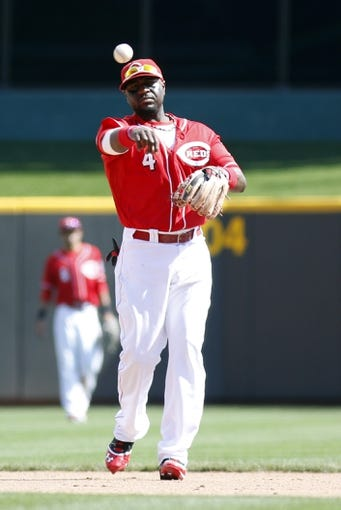 Sep 25, 2013; Cincinnati, OH, USA; Cincinnati Reds second baseman Brandon Phillips throws to first base during a game against the New York Mets at Great American Ball Park. Mandatory Credit: David Kohl-USA TODAY Sports