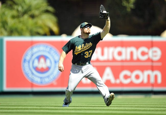 September 25, 2013; Anaheim, CA, USA; Oakland Athletics first baseman Brandon Moss (37) catches a fly ball during the first inning against the Los Angeles Angels at Angel Stadium of Anaheim. Mandatory Credit: Gary A. Vasquez-USA TODAY Sports