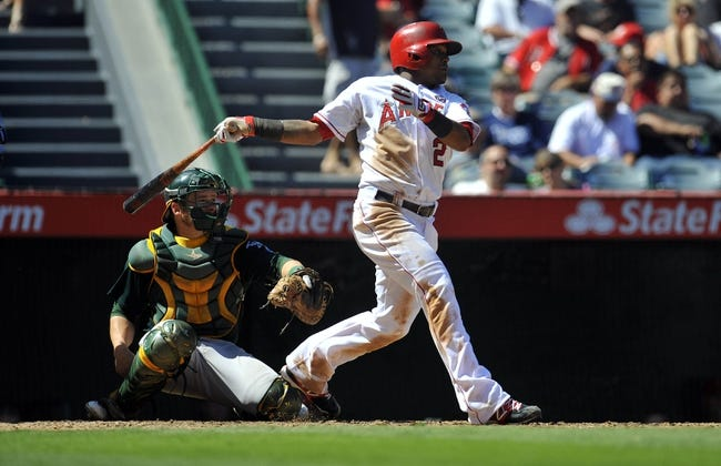 September 25, 2013; Anaheim, CA, USA; Los Angeles Angels shortstop Erick Aybar (2) hits a single during the fourth inning against the Oakland Athletics at Angel Stadium of Anaheim. Mandatory Credit: Gary A. Vasquez-USA TODAY Sports