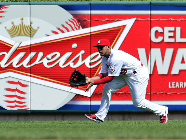 Sep 25, 2013; St. Louis, MO, USA; St. Louis Cardinals center fielder Jon Jay (19) makes a catch against the Washington Nationals at Busch Stadium. The Cardinals defeated the Nationals 4-1. Mandatory Credit: Scott Rovak-USA TODAY Sports