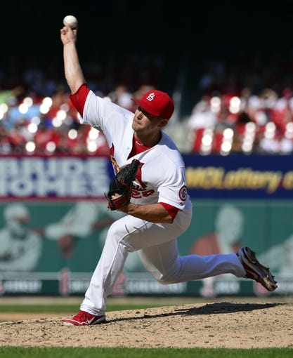 Sep 25, 2013; St. Louis, MO, USA; St. Louis Cardinals relief pitcher Trevor Rosenthal (26) delivers a pitch against the Washington Nationals during the ninth inning at Busch Stadium. The Cardinals defeated the Nationals 4-1. Mandatory Credit: Scott Rovak-USA TODAY Sports