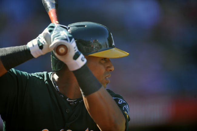 September 25, 2013; Anaheim, CA, USA; Oakland Athletics left fielder Yoenis Cespedes (52) on deck before hitting in the ninth inning against the Los Angeles Angels at Angel Stadium of Anaheim. Mandatory Credit: Gary A. Vasquez-USA TODAY Sports