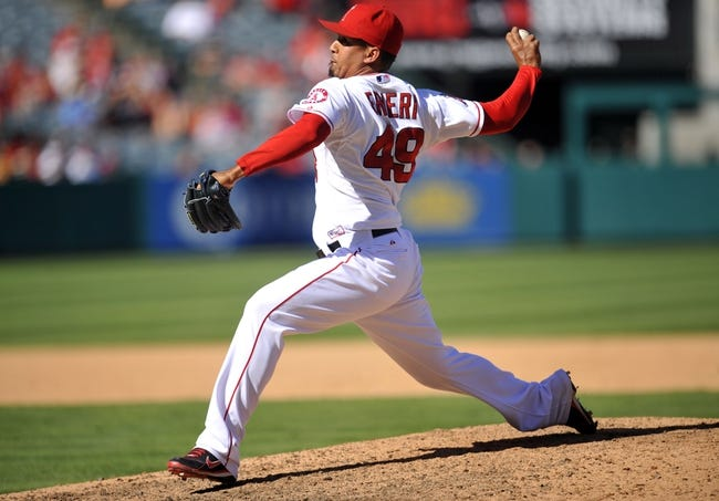 September 25, 2013; Anaheim, CA, USA; Los Angeles Angels relief pitcher Ernesto Frieri (49) pitches during the ninth inning against the Oakland Athletics at Angel Stadium of Anaheim. Mandatory Credit: Gary A. Vasquez-USA TODAY Sports