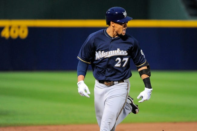 Sep 25, 2013; Atlanta, GA, USA; Milwaukee Brewers center fielder Carlos Gomez (27) reacts to Atlanta Braves players while running the bases after hitting a home run during the first inning at Turner Field. Mandatory Credit: Dale Zanine-USA TODAY Sports