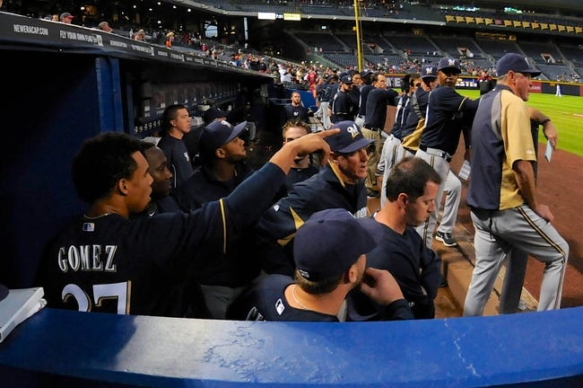 Sep 25, 2013; Atlanta, GA, USA; Milwaukee Brewers center fielder Carlos Gomez (27) reacts in the dugout after being ejected from the game during a confrontation with Atlanta Braves players after hitting a home run during the first inning at Turner Field. Mandatory Credit: Dale Zanine-USA TODAY Sports