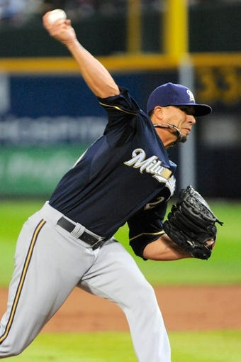 Sep 25, 2013; Atlanta, GA, USA; Milwaukee Brewers starting pitcher Kyle Lohse (26) pitches against the Atlanta Braves during the first inning at Turner Field. Mandatory Credit: Dale Zanine-USA TODAY Sports