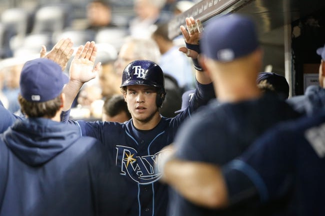 Sep 25, 2013; Bronx, NY, USA;  Tampa Bay Rays right fielder Wil Myers (9) high fives through the dugout after scoring during the first inning against the New York Yankees at Yankee Stadium. Mandatory Credit: Anthony Gruppuso-USA TODAY Sports