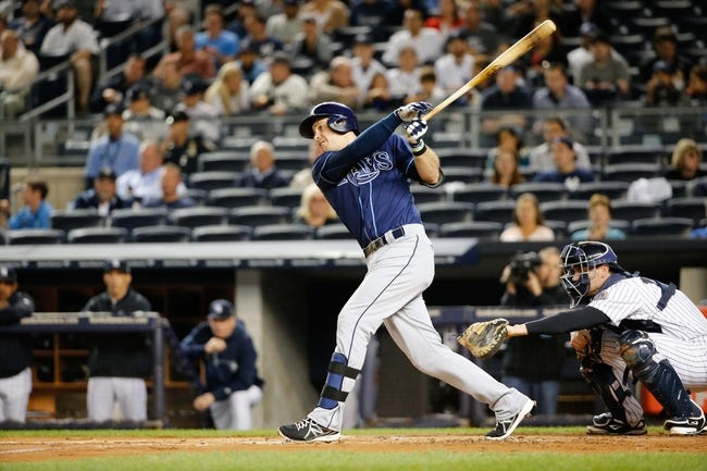 Sep 25, 2013; Bronx, NY, USA;  Tampa Bay Rays third baseman Evan Longoria (3) goes to first on a throwing error by the shortstop during the first inning against the New York Yankees at Yankee Stadium. Mandatory Credit: Anthony Gruppuso-USA TODAY Sports