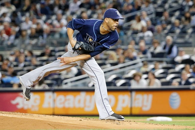 Sep 25, 2013; Bronx, NY, USA; Tampa Bay Rays starting pitcher David Price (14) pitches during the first inning against the New York Yankees at Yankee Stadium. Mandatory Credit: Anthony Gruppuso-USA TODAY Sports
