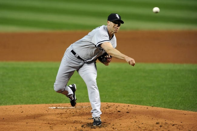 Sep 25, 2013; Cleveland, OH, USA; Chicago White Sox starting pitcher Dylan Axelrod (33) delivers in the first inning against the Cleveland Indians at Progressive Field. Mandatory Credit: David Richard-USA TODAY Sports