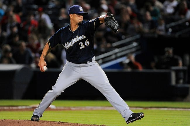 Sep 25, 2013; Atlanta, GA, USA; Milwaukee Brewers starting pitcher Kyle Lohse (26) pitches against the Atlanta Braves during the third inning at Turner Field. Mandatory Credit: Dale Zanine-USA TODAY Sports