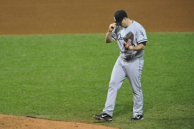 Sep 25, 2013; Cleveland, OH, USA; Chicago White Sox starting pitcher Dylan Axelrod (33) reacts in the fifth inning against the Cleveland Indians at Progressive Field. Mandatory Credit: David Richard-USA TODAY Sports