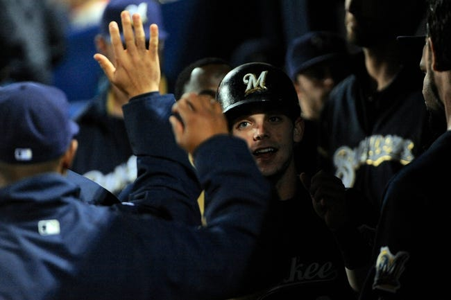 Sep 25, 2013; Atlanta, GA, USA; Milwaukee Brewers second baseman Scooter Gennett (2) high fives in the dugout after scoring a run against the Atlanta Braves during the seventh  inning at Turner Field. Mandatory Credit: Dale Zanine-USA TODAY Sports