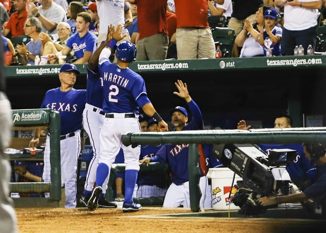 Sep 25, 2013; Arlington, TX, USA; Texas Rangers center fielder Leonys Martin (2) celebrates with teammates after scoring during the fourth inning against the Houston Astros at Rangers Ballpark in Arlington. Mandatory Credit: Kevin Jairaj-USA TODAY Sports