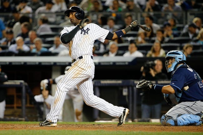 Sep 25, 2013; Bronx, NY, USA;  New York Yankees shortstop Eduardo Nunez (26) hits a solo home run to left during the third inning against the Tampa Bay Rays at Yankee Stadium. Mandatory Credit: Anthony Gruppuso-USA TODAY Sports