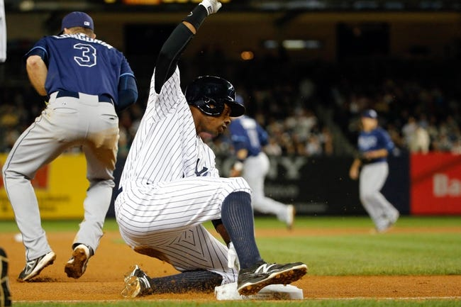 Sep 25, 2013; Bronx, NY, USA;  New York Yankees center fielder Curtis Granderson (14) advances to third during the fourth inning against the Tampa Bay Rays at Yankee Stadium. Mandatory Credit: Anthony Gruppuso-USA TODAY Sports