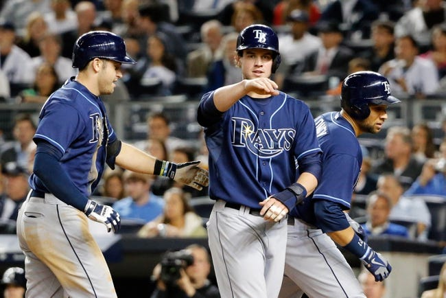 Sep 25, 2013; Bronx, NY, USA;  Tampa Bay Rays right fielder Wil Myers (9) and first baseman James Loney (21) celebrate scoring on the home run hit by third baseman Evan Longoria (3) during the sixth inning against the New York Yankees at Yankee Stadium. Mandatory Credit: Anthony Gruppuso-USA TODAY Sports