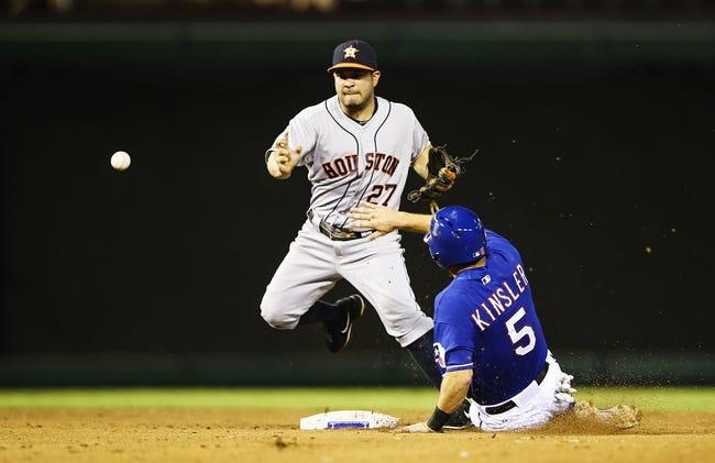 Sep 25, 2013; Arlington, TX, USA; Houston Astros second baseman Jose Altuve (27) cannot turn a double play as Texas Rangers second baseman Ian Kinsler (5) slides into second base during the game at Rangers Ballpark in Arlington. Mandatory Credit: Kevin Jairaj-USA TODAY Sports