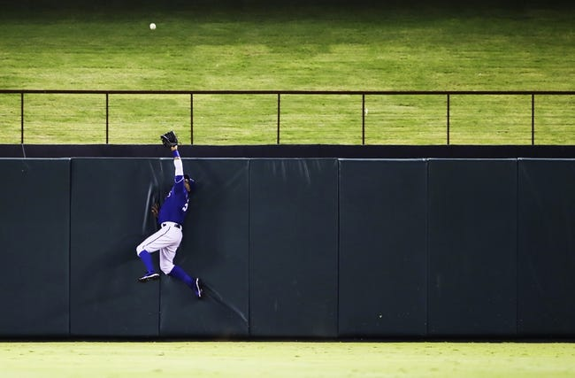 Sep 25, 2013; Arlington, TX, USA; Texas Rangers center fielder Leonys Martin (2) cannot catch a home run hit by Houston Astros designated hitter Brandon Laird (not pictured) during the fourth inning at Rangers Ballpark in Arlington. Mandatory Credit: Kevin Jairaj-USA TODAY Sports