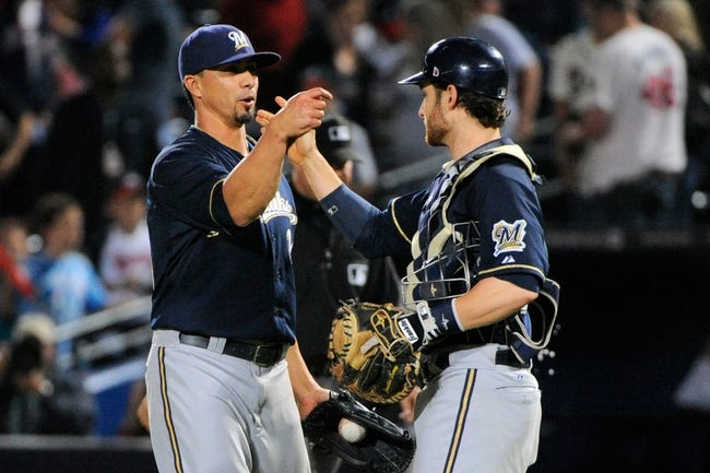 Sep 25, 2013; Atlanta, GA, USA; Milwaukee Brewers starting pitcher Kyle Lohse (26) and catcher Jonathan Lucroy (20) react after defeating the Atlanta Braves at Turner Field. The Brewers defeated the Braves 4-0. Mandatory Credit: Dale Zanine-USA TODAY Sports