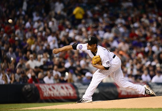 Sep 25, 2013; Denver, CO, USA; Colorado Rockies starting pitcher Jhoulys Chacin (45) delivers a pitch in the first inning of the game against the Boston Red Sox at Coors Field. Mandatory Credit: Ron Chenoy-USA TODAY Sports