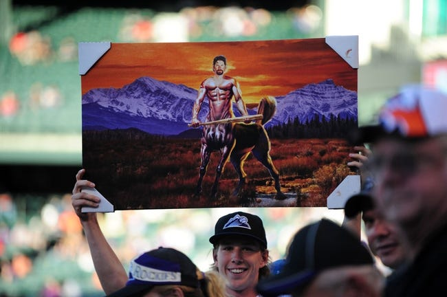 Sep 25, 2013; Denver, CO, USA; A Colorado Rockies fan holds a painting of first baseman Todd Helton (not pictured) before the game against the Boston Red Sox at Coors Field. Mandatory Credit: Ron Chenoy-USA TODAY Sports