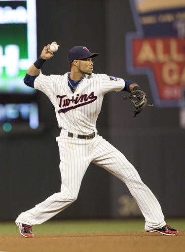 Sep 25, 2013; Minneapolis, MN, USA; Minnesota Twins shortstop Pedro Florimon (25) throws the ball to first base in the fourth inning against the Detroit Tigers at Target Field. Mandatory Credit: Jesse Johnson-USA TODAY Sports