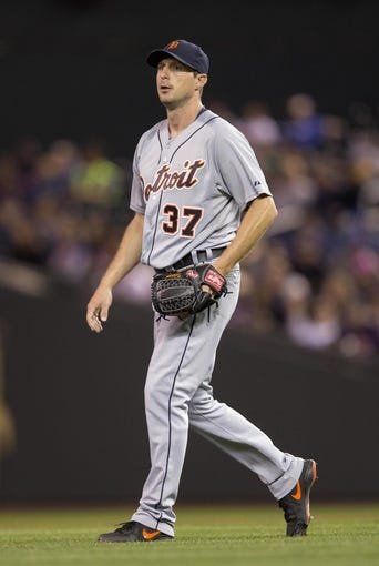 Sep 25, 2013; Minneapolis, MN, USA; Detroit Tigers starting pitcher Max Scherzer (37) looks on after getting an out in the fifth inning against the Minnesota Twins at Target Field. Mandatory Credit: Jesse Johnson-USA TODAY Sports