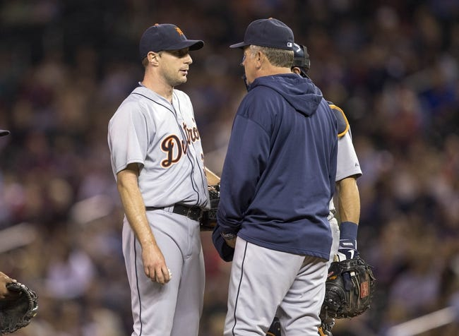 Sep 25, 2013; Minneapolis, MN, USA; Detroit Tigers pitching coach Jeff Jones talks to starting pitcher Max Scherzer (37) in the fifth inning against the Minnesota Twins at Target Field. Mandatory Credit: Jesse Johnson-USA TODAY Sports