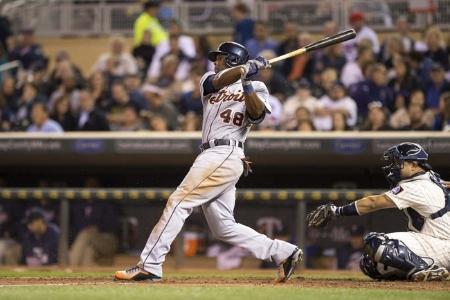 Sep 25, 2013; Minneapolis, MN, USA; Detroit Tigers right fielder Torii Hunter (48) hits a single in the sixth inning against the Minnesota Twins at Target Field. Mandatory Credit: Jesse Johnson-USA TODAY Sports