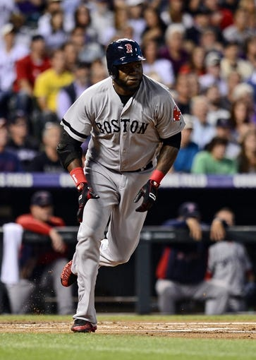 Sep 25, 2013; Denver, CO, USA; Boston Red Sox designated hitter David Ortiz (34) runs after hitting a double in the second inning of the game against the Colorado Rockies at Coors Field. Mandatory Credit: Ron Chenoy-USA TODAY Sports