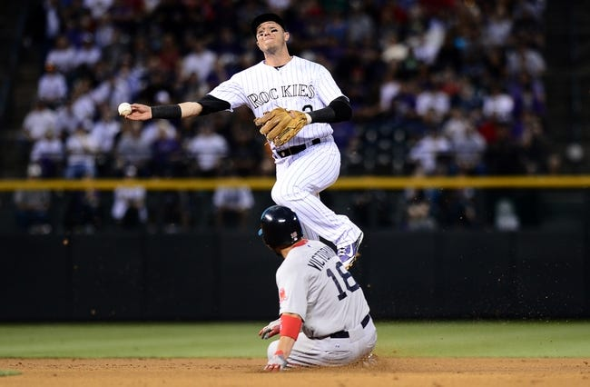 Sep 25, 2013; Denver, CO, USA; Colorado Rockies shortstop Troy Tulowitzki (2) attempts to turn a double play as Boston Red Sox third baseman Will Middlebrooks (16) slides into second base in the second inning of the game at Coors Field. Mandatory Credit: Ron Chenoy-USA TODAY Sports
