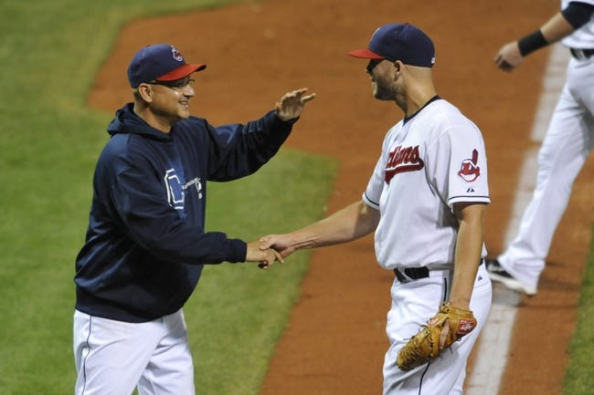 Sep 25, 2013; Cleveland, OH, USA; Cleveland Indians manager Terry Francona (left) and relief pitcher Justin Masterson celebrate a 7-2 win over the Chicago White Sox at Progressive Field. Mandatory Credit: David Richard-USA TODAY Sports