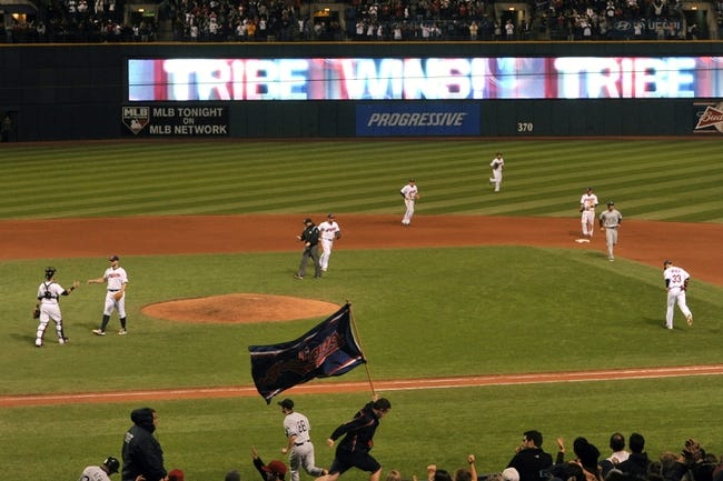 Sep 25, 2013; Cleveland, OH, USA; The Cleveland Indians celebrate a 7-2 win over the Chicago White Sox at Progressive Field. Mandatory Credit: David Richard-USA TODAY Sports