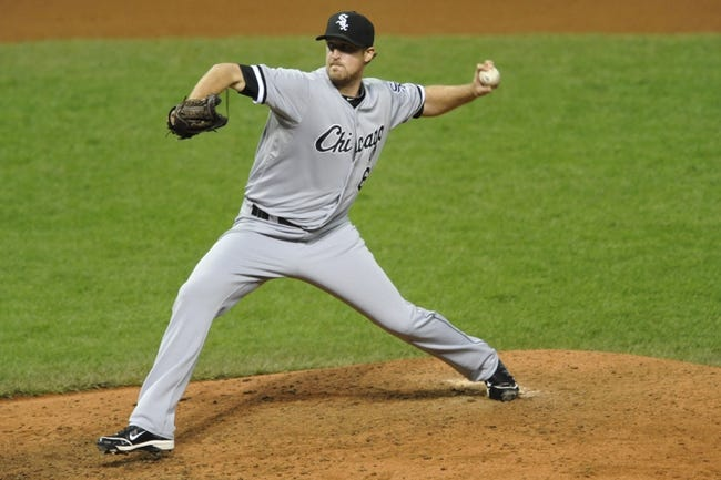 Sep 25, 2013; Cleveland, OH, USA; Chicago White Sox starting pitcher Charlie Leesman delivers in the seventh inning against the Cleveland Indians at Progressive Field. Mandatory Credit: David Richard-USA TODAY Sports