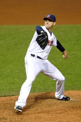 Sep 25, 2013; Cleveland, OH, USA; Cleveland Indians relief pitcher Rich Hill delivers in the seventh inning against the Chicago White Sox at Progressive Field. Mandatory Credit: David Richard-USA TODAY Sports