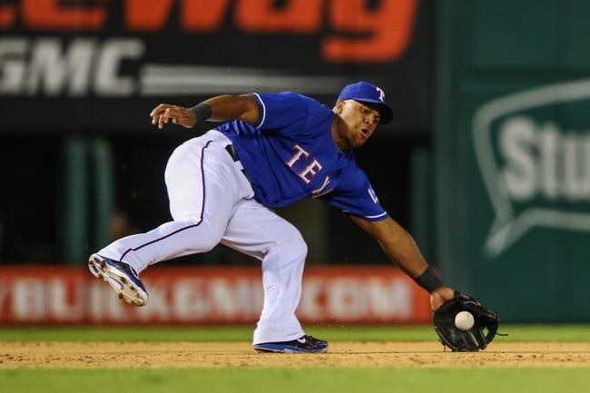 Sep 25, 2013; Arlington, TX, USA; Texas Rangers third baseman Adrian Beltre (29) makes a diving play during the game against the Houston Astros at Rangers Ballpark in Arlington. Mandatory Credit: Kevin Jairaj-USA TODAY Sports