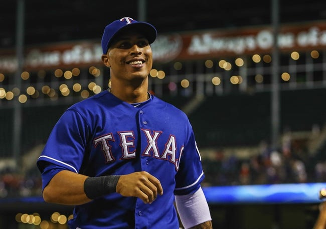 Sep 25, 2013; Arlington, TX, USA; Texas Rangers center fielder Leonys Martin (2) laughs after the victory over the Houston Astros at Rangers Ballpark in Arlington. Mandatory Credit: Kevin Jairaj-USA TODAY Sports