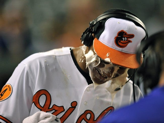 Sep 25, 2013; Baltimore, MD, USA; Baltimore Orioles second baseman Jonathan Schoop (6) gets a shaving cream pie after making his major league debut against the Toronto Blue Jays at Oriole Park at Camden Yards. The Orioles defeated the Blue Jays 9-5. Mandatory Credit: Joy R. Absalon-USA TODAY Sports