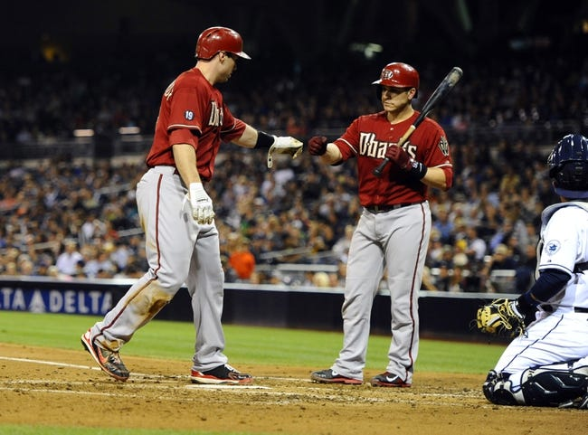 Sep 25, 2013; San Diego, CA, USA; Arizona Diamondbacks first baseman Paul Goldschmidt (44) is congratulated by catcher Miguel Montero (26) after scoring on a balk by San Diego Padres starting pitcher Ian Kennedy (not pictured) during the fourth inning at Petco Park. Mandatory Credit: Christopher Hanewinckel-USA TODAY Sports