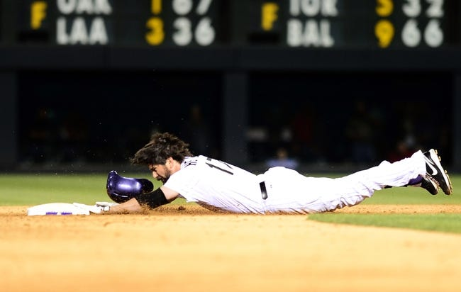 Sep 25, 2013; Denver, CO, USA; Colorado Rockies first baseman Todd Helton (17) slides into second after hitting a double in the fifth inning of the game against the Boston Red Sox at Coors Field. Mandatory Credit: Ron Chenoy-USA TODAY Sports