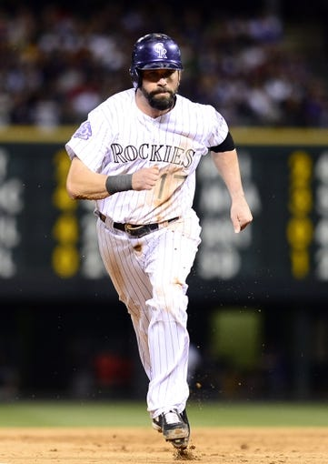 Sep 25, 2013; Denver, CO, USA; Colorado Rockies first baseman Todd Helton (17) runs towards third base in the fifth inning of the game against the Boston Red Sox at Coors Field. Mandatory Credit: Ron Chenoy-USA TODAY Sports