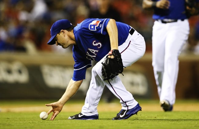 Sep 25, 2013; Arlington, TX, USA; Texas Rangers relief pitcher Jason Frasor (44) cannot field a ground ball during the game against the Houston Astros at Rangers Ballpark in Arlington. Mandatory Credit: Kevin Jairaj-USA TODAY Sports