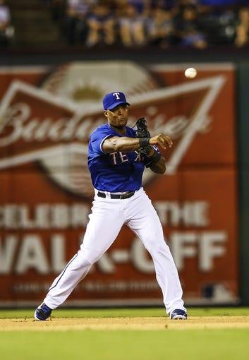 Sep 25, 2013; Arlington, TX, USA; Texas Rangers third baseman Adrian Beltre (29) throws to first base during the game against the Houston Astros at Rangers Ballpark in Arlington. Mandatory Credit: Kevin Jairaj-USA TODAY Sports