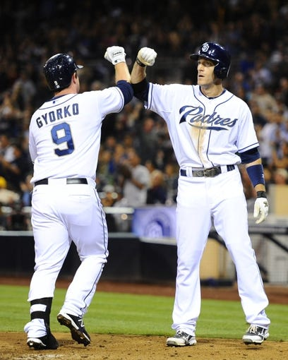 Sep 25, 2013; San Diego, CA, USA; San Diego Padres second baseman Jedd Gyorko (9) is congratulated by right fielder Chris Denorfia (13) after a home run during the fifth inning against the Arizona Diamondbacks at Petco Park. Mandatory Credit: Christopher Hanewinckel-USA TODAY Sports