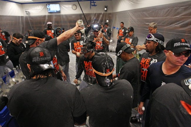 Sep 25, 2013; Minneapolis, MN, USA; Detroit Tigers celebrate in the locker room after beating the Minnesota Twins and winning the Central Division Championship at Target Field. The Tigers won 1-0. Mandatory Credit: Jesse Johnson-USA TODAY Sports